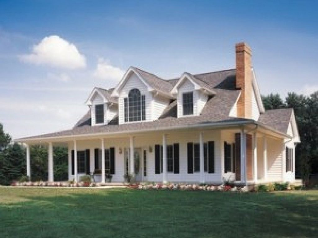 Large white house with big porch and dormer windows with white vinyl siding