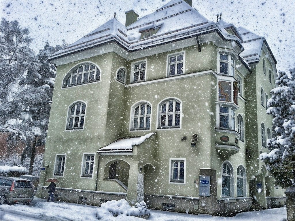 Big townhouse with lots of windows in the snow