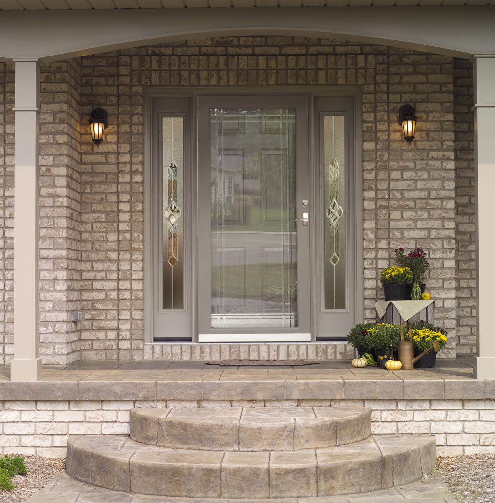 gray brick home with ProVia custom entry and storm doors installed by Paul Henry's Windows Installation