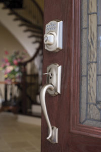 Photo showing the hardware on an entry door with nickel finish zoomed in and installed by Paul Henry's Windows